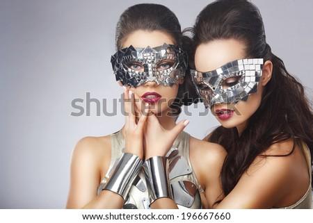 Masquerade. Artistic Women in Fancy Bright Glasses - stock photo