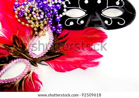 masquerade ball masks and beads - stock photo