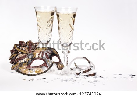 Masquerade mask and champagne isolated on white background. - stock photo