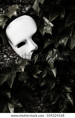 Masquerade - Phantom of the Opera Mask on Ivy Wall - stock photo