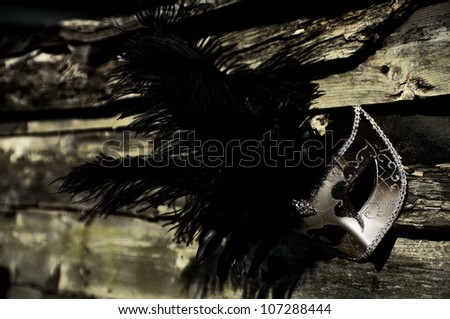 Masquerade - Silver Venetian Mask on Weathered Fence - stock photo