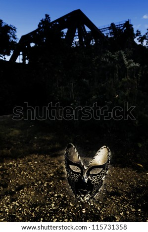 Masquerade - Venetian Mask and Old Bridge - stock photo
