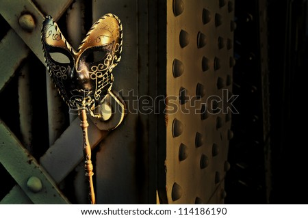 Masquerade - Venetian Mask on Vintage Bridge - stock photo