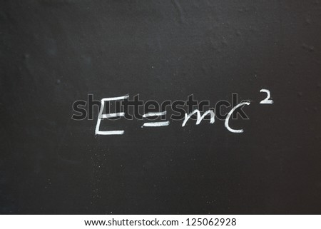 mass energy equation writen in blackboard - stock photo