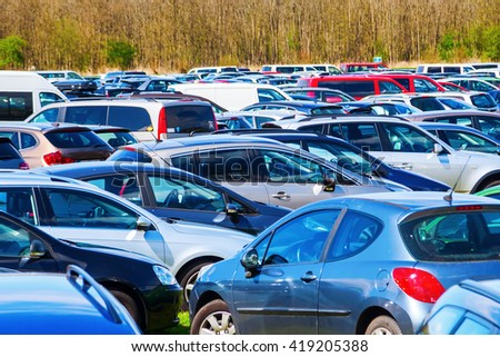 mass of parked cars on a parking space - stock photo