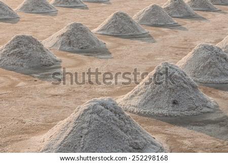 Mass of salt in the salt sea salt farm in the evening. - stock photo