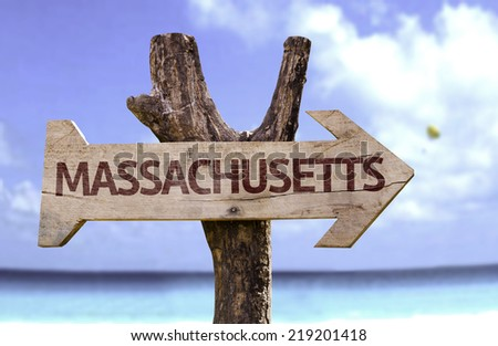Massachusetts wooden sign with a beach on background - stock photo