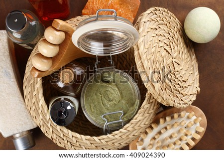 Massage and bodycare items in basket - stock photo
