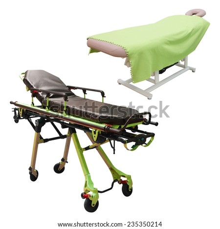 massage bed and stretcher under the white background - stock photo