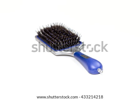 Massage black comb isolated on white - stock photo