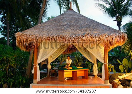 Massage in tropical spa.  - stock photo