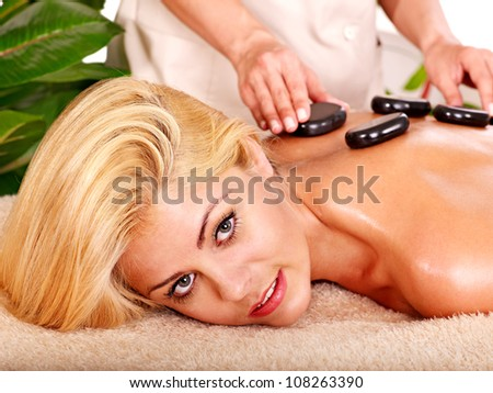Massage of blond woman  in spa.
