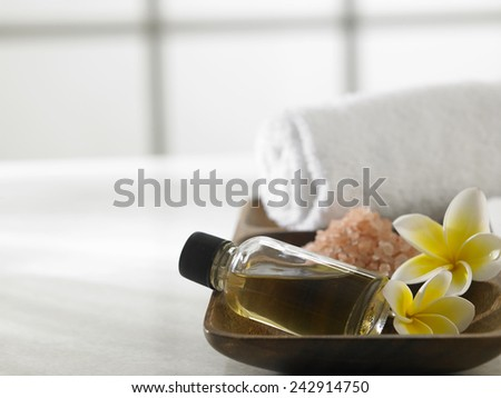 massage oil,salt and towel for the spa concept - stock photo