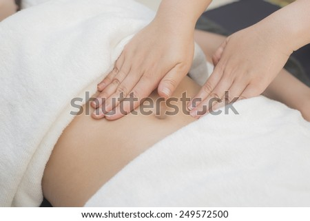 Massage series : Therapist massaging client stomach