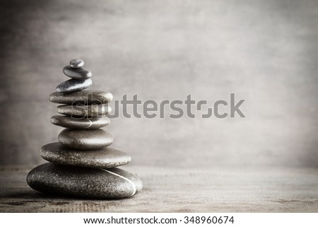 Massage stones put in the form of a pyramid. - stock photo