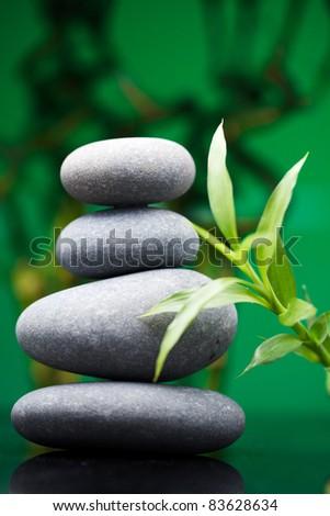 Massage stones with bamboo - stock photo