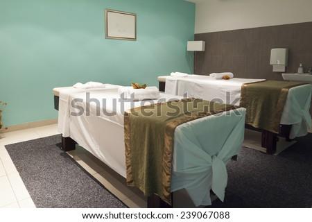 massage table in hotel spa interior - stock photo