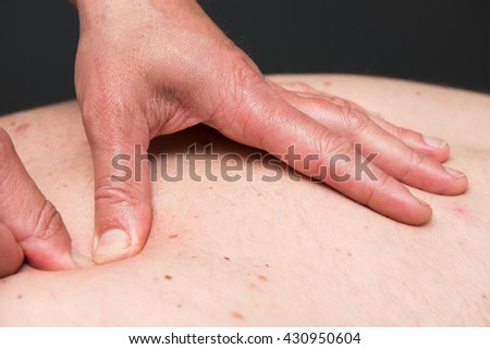 Massage therapist is working with a client