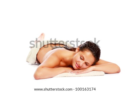 Massage with hot stone - stock photo