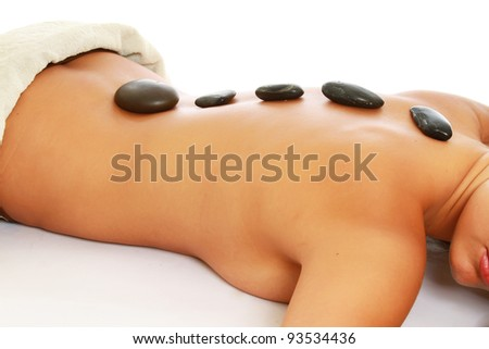 Massage with hot stone , isolated on white background - stock photo