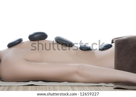 Massage with hot volcanic stones - stock photo