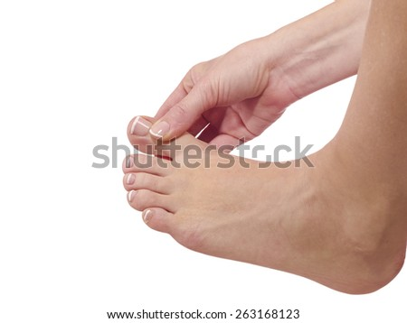 massaging her toe, health concept