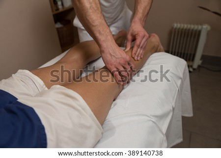 Masseur Doing Massage On Man Body In The Spa Salon