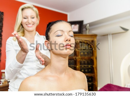 masseuse beating with her Hands on the shoulder of a woman - stock photo