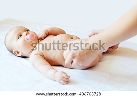 Masseuse massaging little baby girl, selective focus