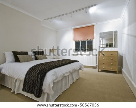 massive bedroom with hard wood modern furniture - stock photo