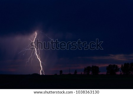 Massive, brilliant lightning bolt in an empty field