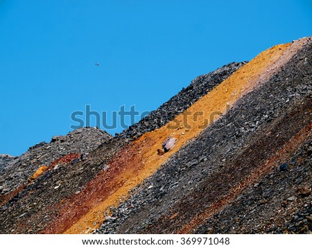 Massive dump of depleted metal ore - stock photo