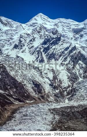 Massive glacier at the foot of Nanga Parbat mountain in the Karakorum range, Pakistan - stock photo