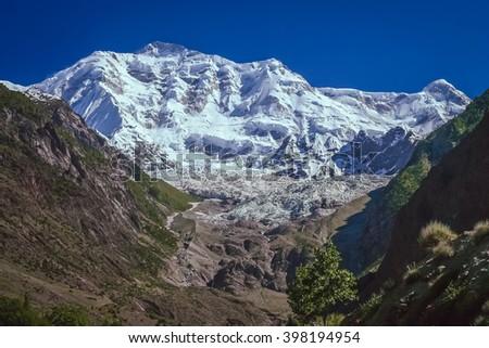 Massive, imposing and beautiful Rakaposhi peak in Karakorum mountains, Pakistan - stock photo