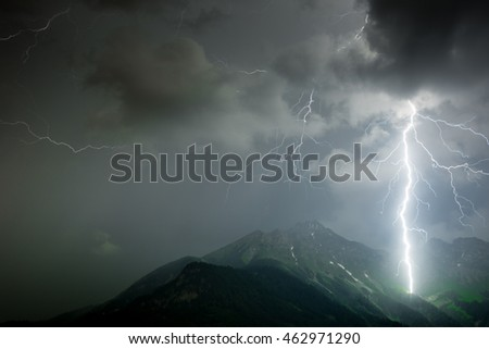 Massive lightning during a thunderstorm in the mountains, alps