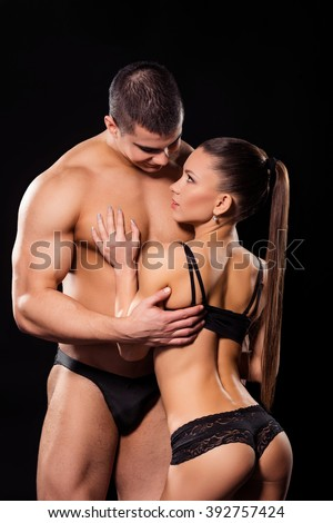 Massive man hugging fit woman. Huge guy embraces lean girl. Don't ever let go. Time is gold for lovers. - stock photo