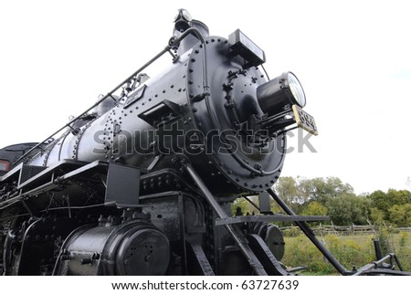 massive refurbished Canadian Railway steam locomotive on display in railroad museum - stock photo