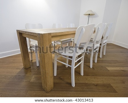 massive retro dining table with six white wooden chairs - stock photo