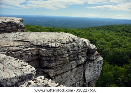 Massive rocks and view to the valley at Minnewaska State Park Reserve Upstate NY during summer time - stock photo
