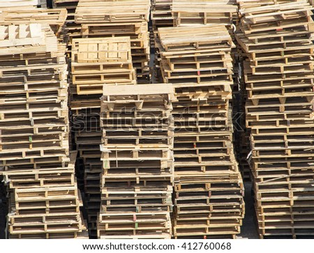 Massive stacks of wooden pallets