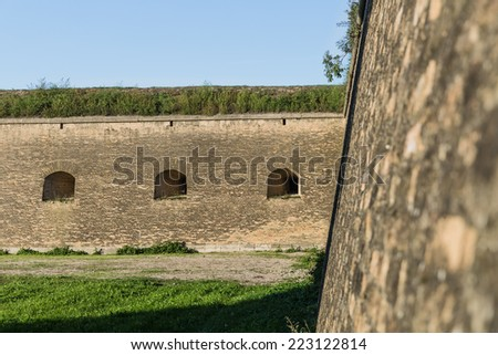 Massive walls and gun ports of the fortification system of the bastion type in Slovak town Komarno . - stock photo