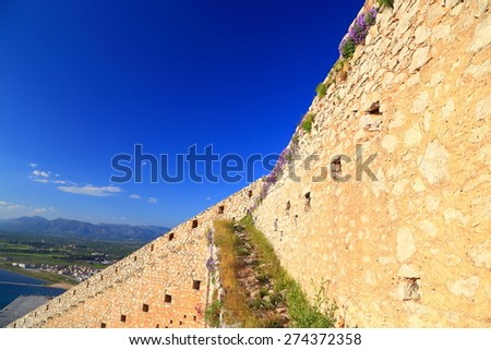 Massive walls of Palamidi fortress in the afternoon light, Nafplio, Greece - stock photo