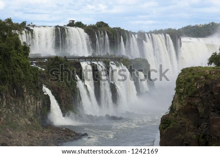 Massive waterfalls cut their way through the tropical jungle. - stock photo