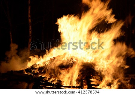 massive wood fire in winter night