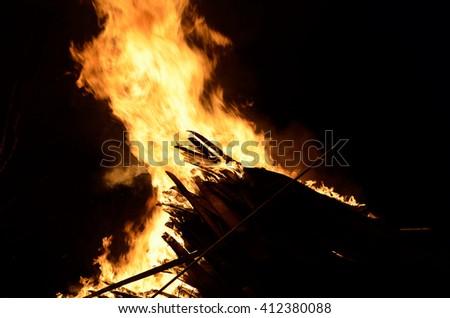 massive wood fire in winter night - stock photo
