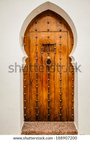 Massive wooden door with metal bolts and doorknob