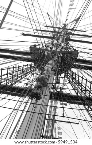 Mast and ropes of a classic sailboat, impression in black and white