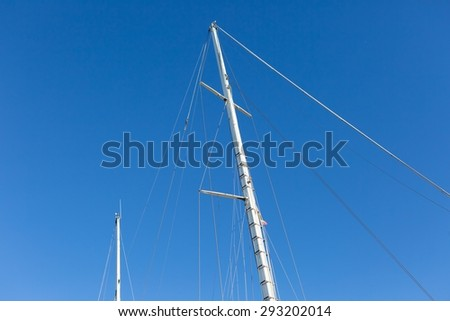 Mast of big white ship moored in port. Port in Jastarnia, Poland.