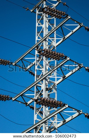 Mast of electricity transmission on blue sky background