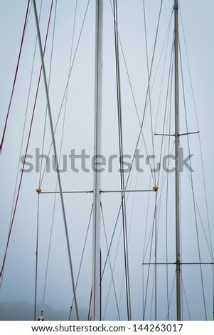 mast yacht without sails against the sky